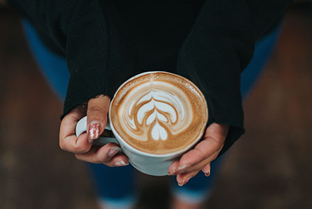Mom holding coffee - therapy for moms in orange county